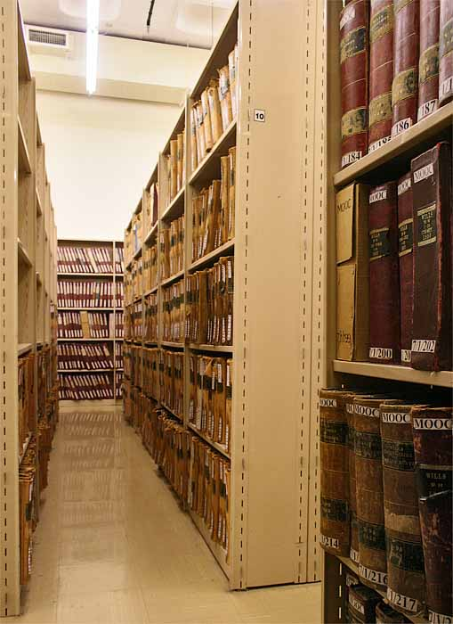 2. Archives on the shelves in a stack room